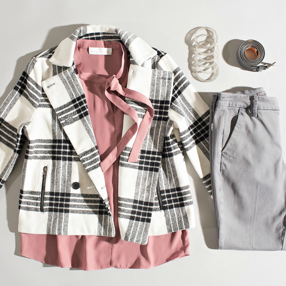 blush top with plaid jacket and gray trousers