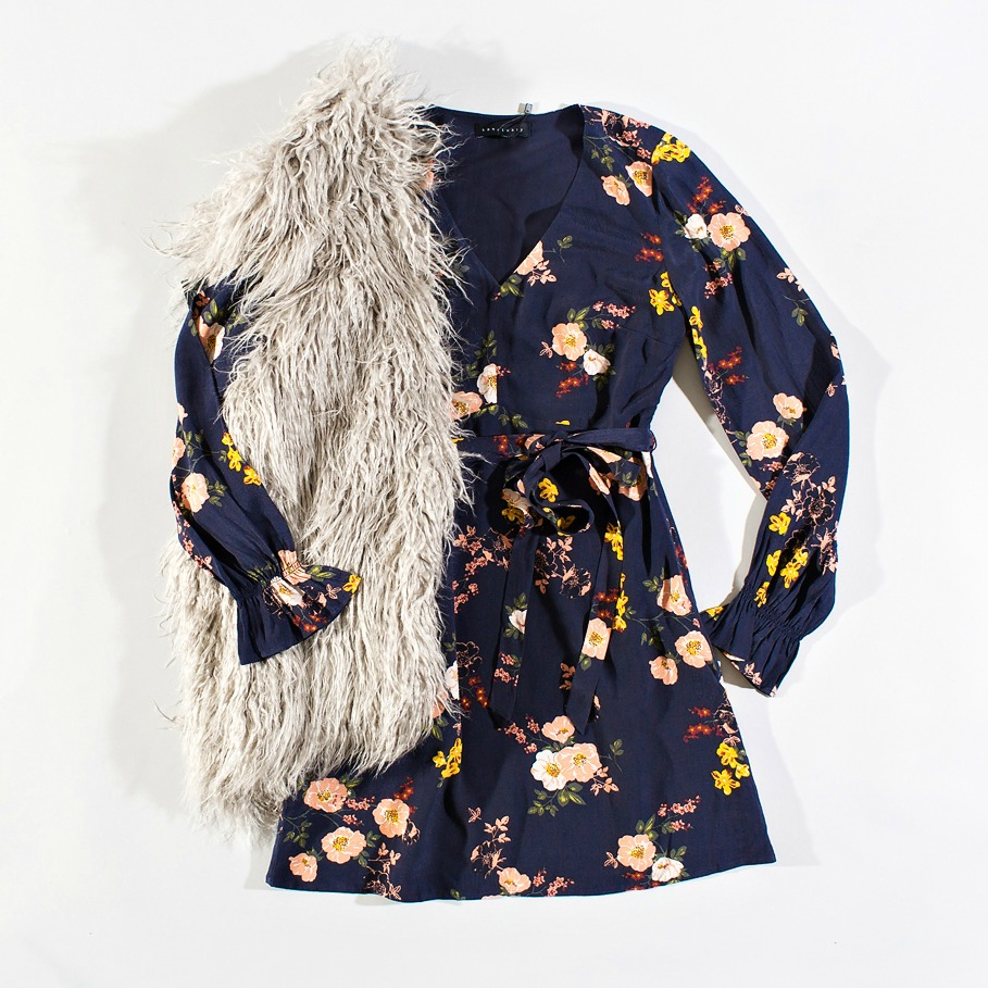 summer floral dress layered with a fuzzy fall vest