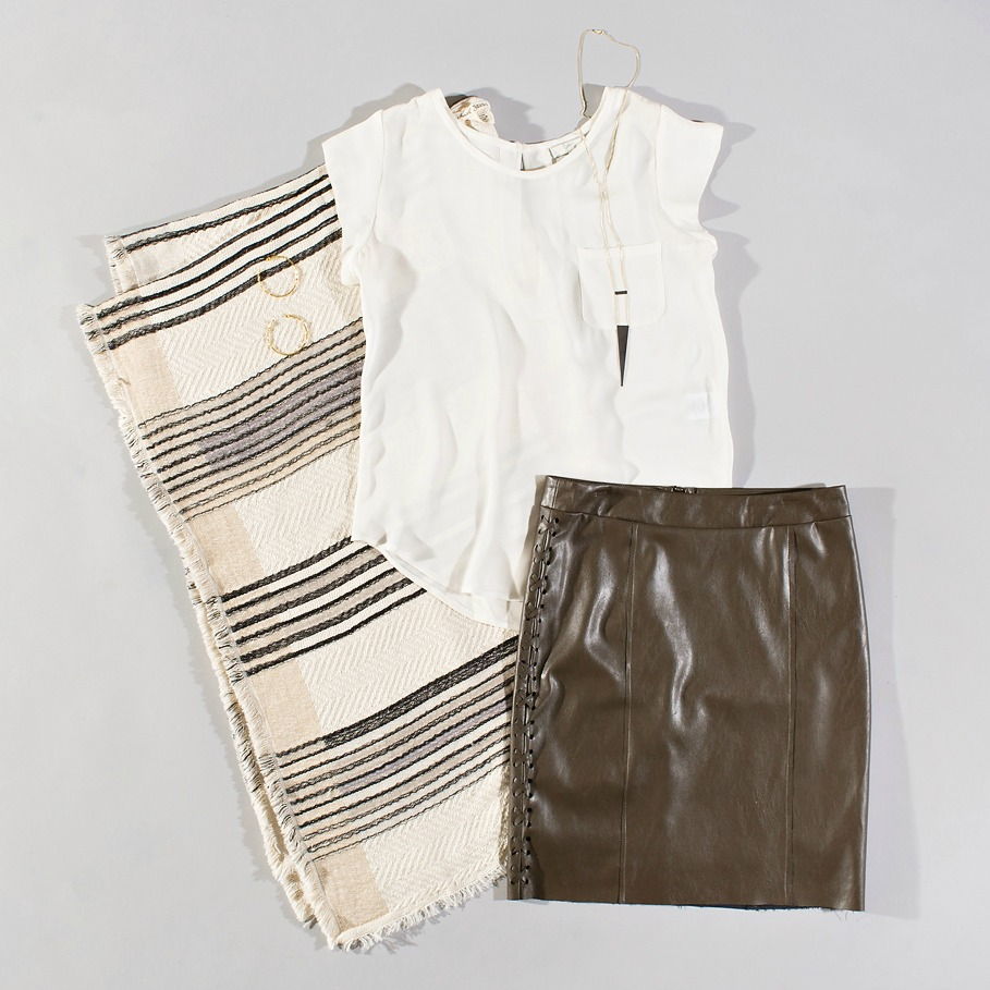 white silk top styled with a coco leather skirt and poncho