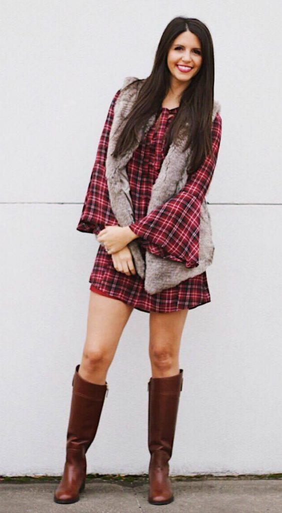 thanksgiving outfit ideas plaid dress tall boots fur vest