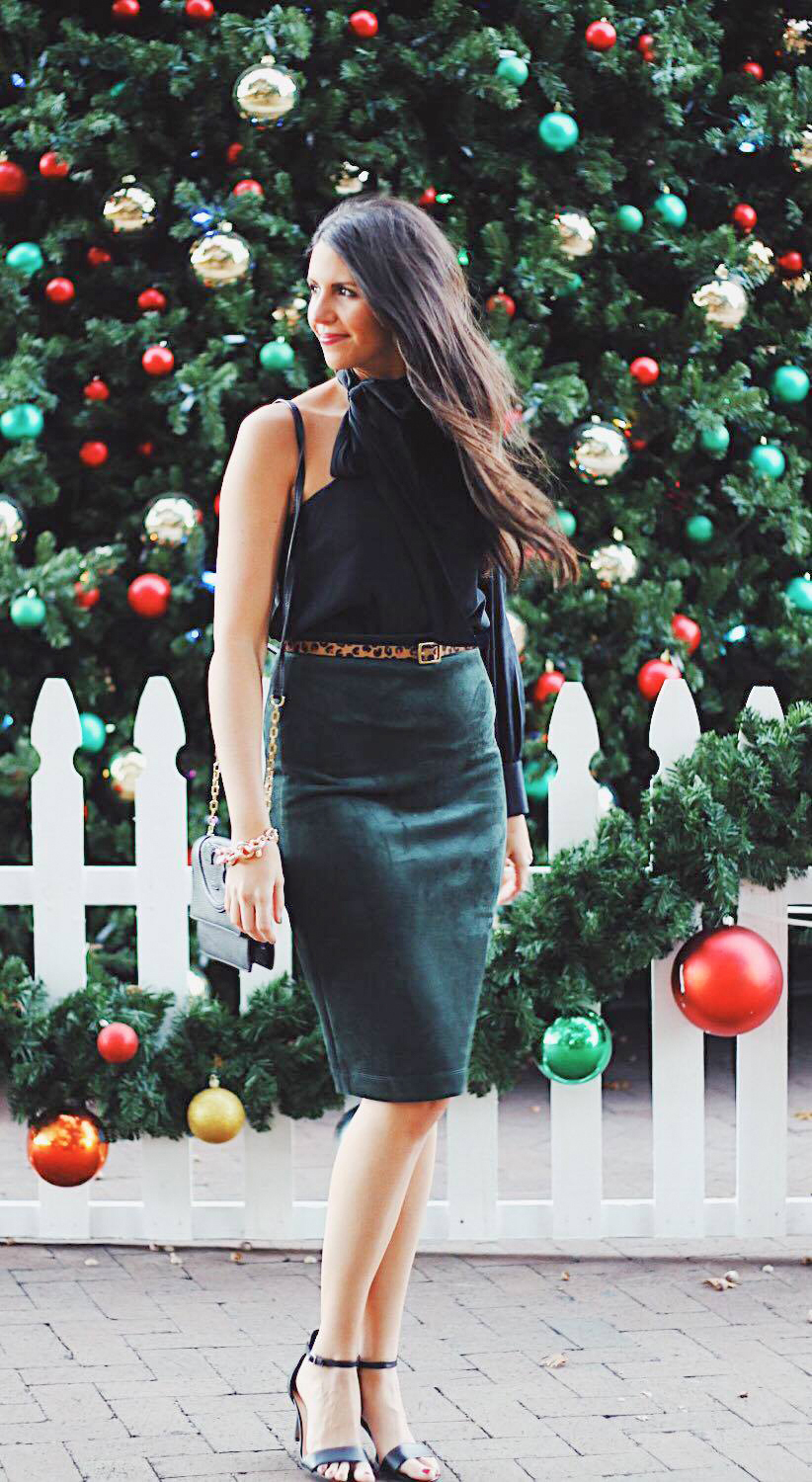 Emerald luxe - Holiday party outfit 3. Pair the velvet skirt with a leopard belt to create an interesting and seamless look.